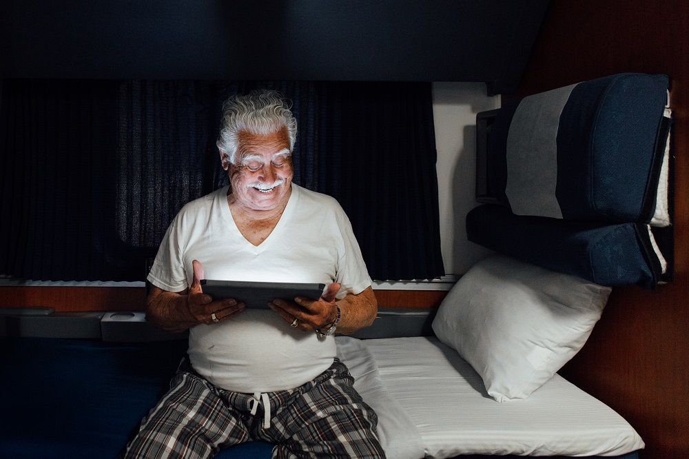 superliner-accessible-bedroom-tablet-at-night